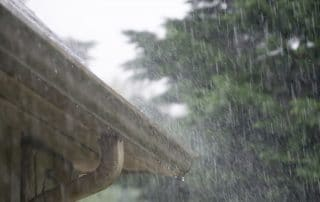 Rain pouring on residential roof